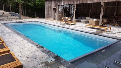 Mulmur Ontario Fiberglass Pool and Landscape Project Located 20 minutes outside the Orangeville area. The Infinity 40 foot Swimming Pool , Silver Grey