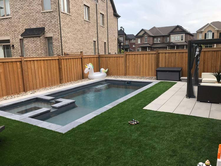 Kincardine Street,  Kleinburg Ontario ,Limitless Graphite Grey Fiberglass Swimming  Pool and  Child Friendly Landscaped Project